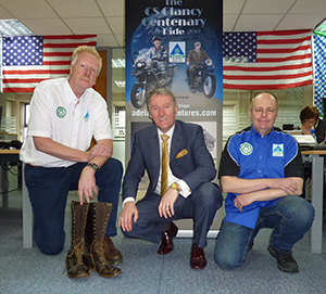 Geoff Hill with Clancy's boots, Adelaide Insurance Services director Sam Geddis and Gary Walker at the Adelaide HQ launch in Belfast
