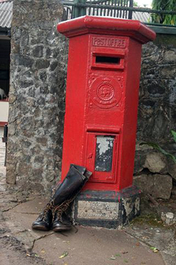 Clancys-boots-postbox-at-Sigiri-Rest-House-small